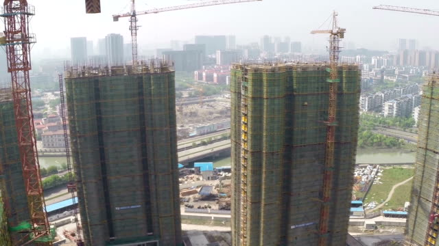 Busy construction site and cranes,aerial view.