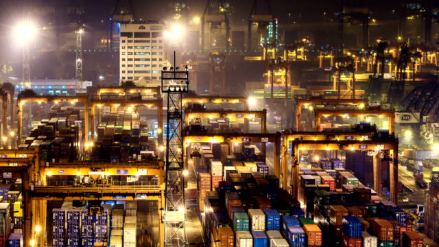 busy container harbor  hong kong at night, timelapse. - cargo container stock videos & royalty-free footage
