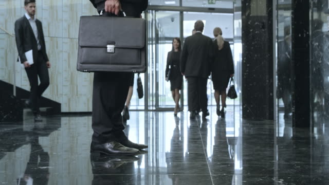 ds busy corporate building lobby - briefcase stock videos & royalty-free footage