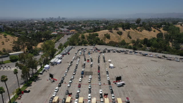 busy covid-19 drive-thru testing site located in the parking lot of dodger stadium, in los angeles, california, u.s., on tuesday, july 7, 2020. - car park stock videos & royalty-free footage