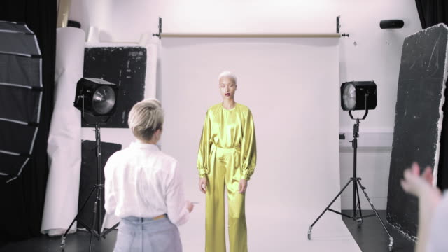 busy crew working on a fashion photoshoot in studio - catwalk stock videos & royalty-free footage