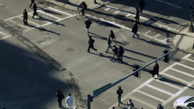 busy crosswalk, aerial view - crosswalk stock videos & royalty-free footage