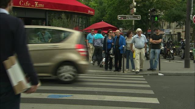 Busy Crosswalk in Montmartre, Paris, France