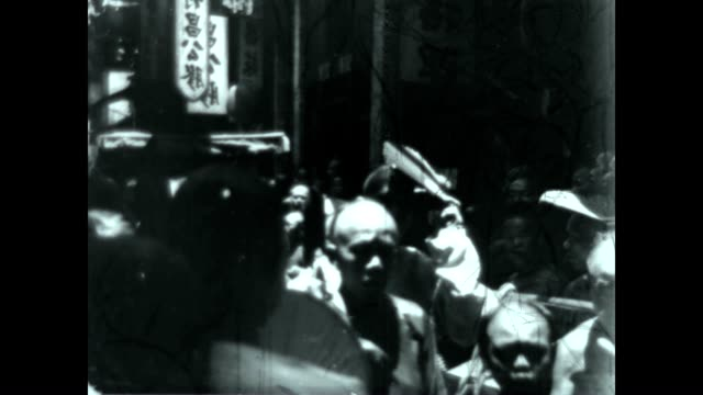 Busy crowded street in Peking by Travelogue Pioneer Burton Holmes