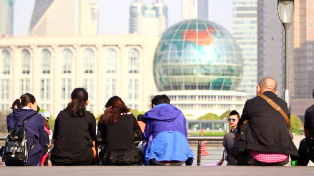busy crowds overlooking the bund and huangpu river - shanghai, china - river huangpu stock videos & royalty-free footage
