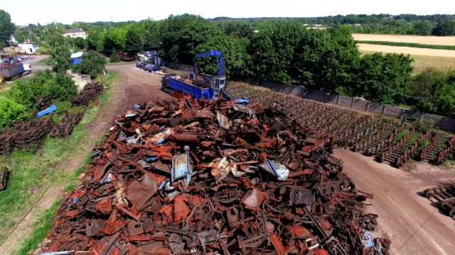 busy day at junkyard. mechanical claw drop metal scrap. aerial view - mode of transport stock videos & royalty-free footage