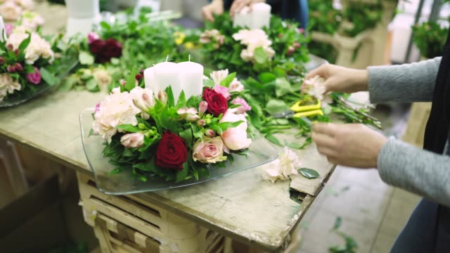 busy day in flower workshop - flower arrangement stock videos and b-roll footage
