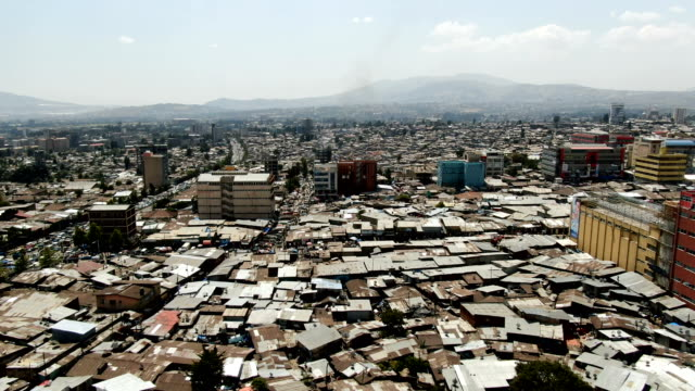 busy day in merkato  outdoor market in the squatter camp with people in the street / aerial view - アジスアベバ点の映像素材/bロール