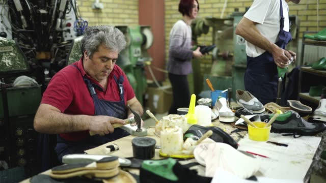 Busy day in shoe factory