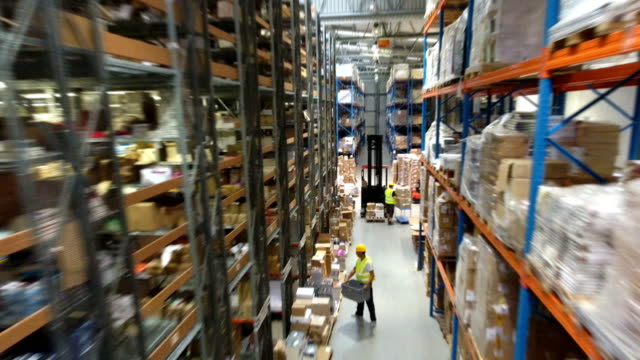 busy day in the warehouse. drone point of view - officina video stock e b–roll