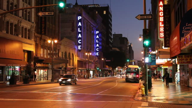 ws busy downtown street at night / los angeles, california, usa - sign stock-videos und b-roll-filmmaterial