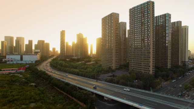 busy elevated road and modern buildings in midtown of modern city at sunrise - tianjin stock videos & royalty-free footage