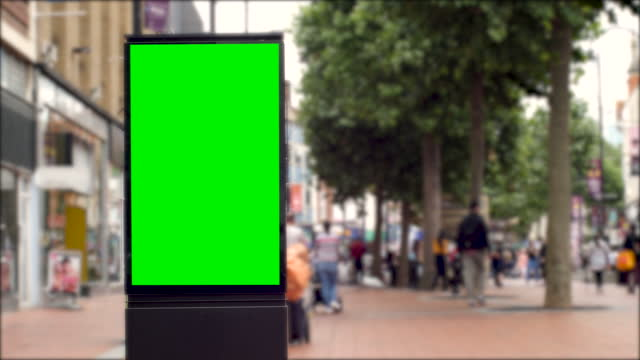 4k busy european city centre shopping retail high street with advertising billboard green screen. chromakey with copy space - poster stock videos & royalty-free footage