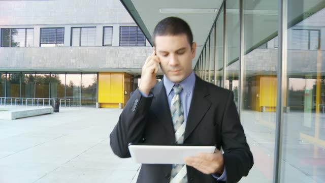 HD STEADY: Busy Executive On Office Walkway