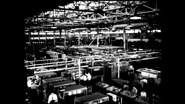 busy factory floors with assembly lines and conveyor belts, lots of workers working; ship launched to sea; battleships at sea and warplanes flying... - 1940 1949 stock videos & royalty-free footage