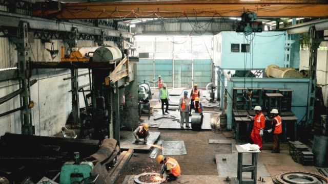 busy factory workers on a workshop floor - metal industry stock videos and b-roll footage