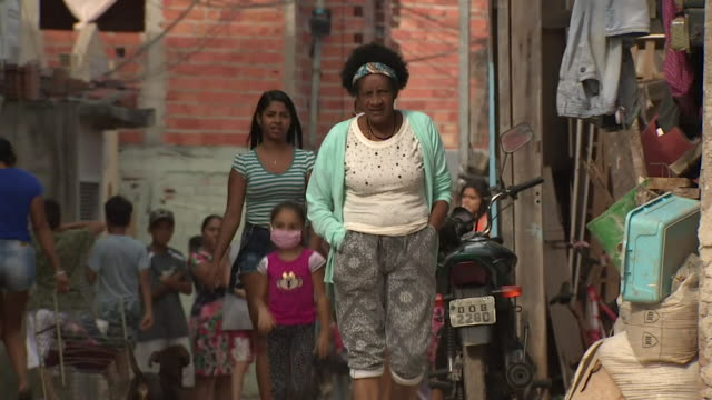 busy favela in sao paul, brazil, where people aren't being told to stay indoors during the coronavirus pandemic - south america stock videos & royalty-free footage
