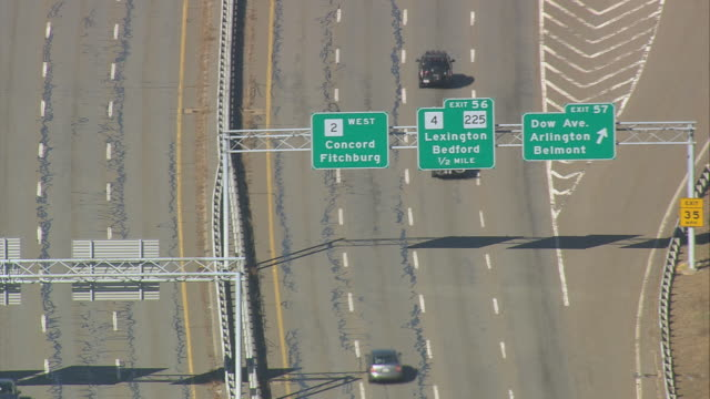 vidéos et rushes de aerial busy four lane highway with overhead signs at exit / boston, massachusetts, united states - ressortir