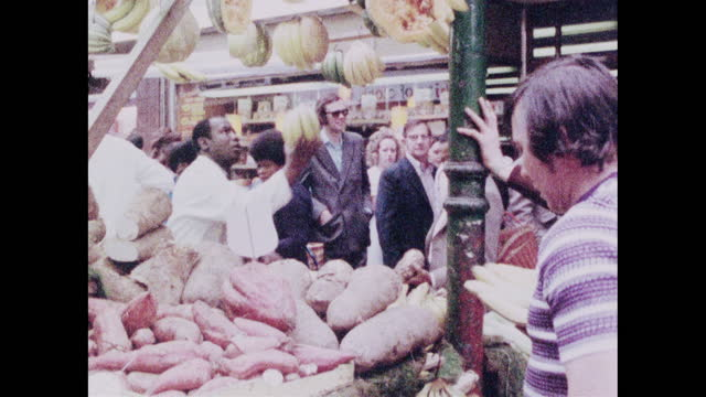 busy fruit and vegetable market stall in brixton; 1973 - selling stock videos & royalty-free footage