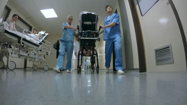 pov busy hallway of a hospital - ward stock videos & royalty-free footage