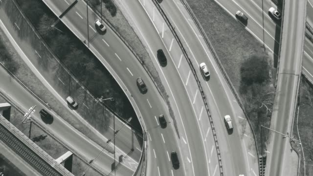 busy highway intersection from above - cinemagraph - grayscale stock videos and b-roll footage