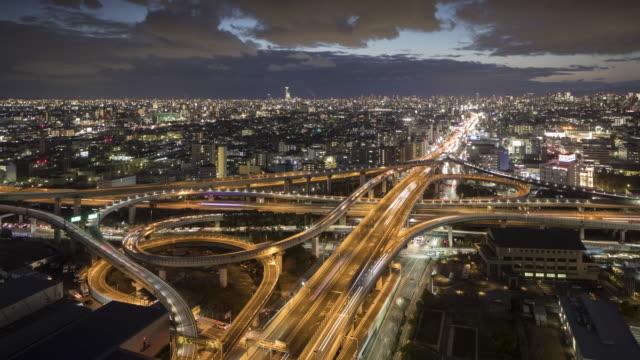 vídeos de stock e filmes b-roll de a busy highway junction in osaka, japan. - road junction