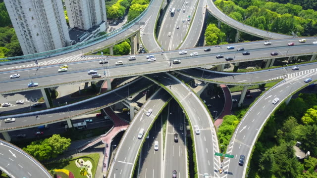Busy highway overpass in Shanghai, China, aerial