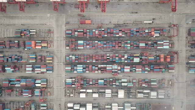 busy industrial port with containers ship - anchored stock videos & royalty-free footage