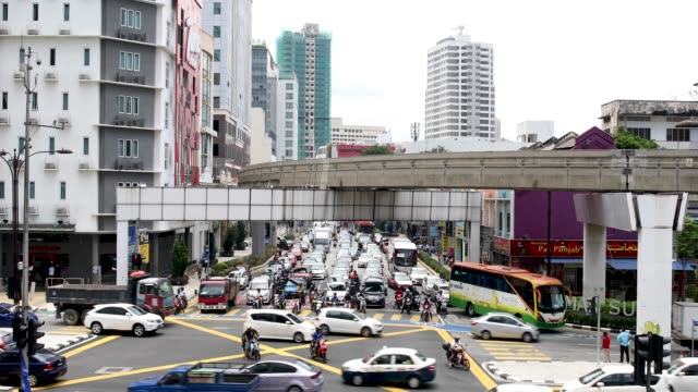 busy intersection and traffic in kuala lumpur - traffic light stock videos & royalty-free footage