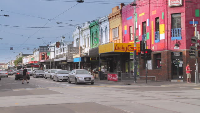 ms t/l busy intersection at chapel street shopping precinct / melbourne, victoria, australia - victoria australia stock videos & royalty-free footage