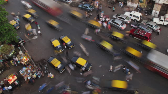 t/l ws ha busy intersection at crawford market, day to night / mumbai, india - chaos stock videos & royalty-free footage