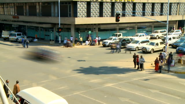 t/l of busy intersection filled with people and cars, harare, zimbabwe - zimbabwe stock videos & royalty-free footage