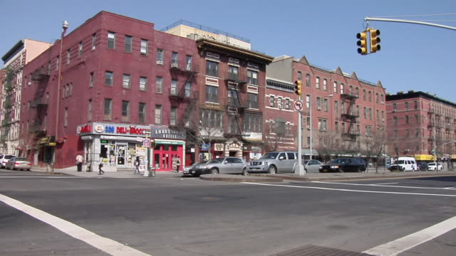 ws busy intersection in front of mgi in harlem / new york, united states - harlem stock videos & royalty-free footage