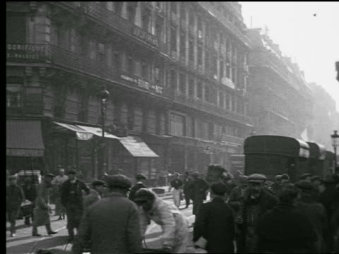 b/w 1927 busy intersection with people walking + pushing carts / paris, france - horsedrawn stock videos & royalty-free footage