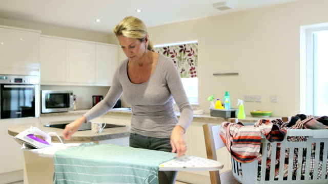 busy ironing in the kitchen - laundry basket stock videos and b-roll footage