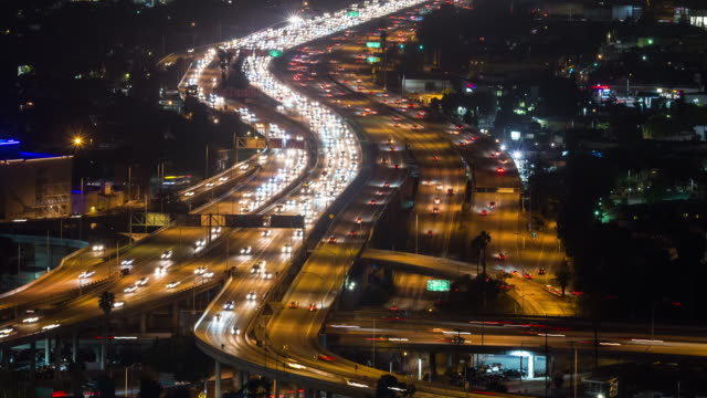 a busy los angeles freeway interchange at night - traffic time lapse stock videos & royalty-free footage
