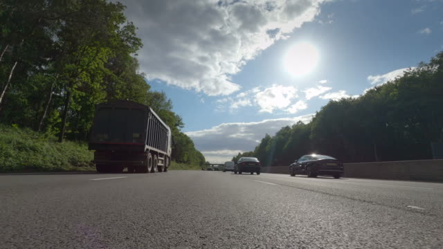 a busy m3 motorway as commuters return home during rush hour on may 13 in surrey england this is the day england eased the lockdown rules in the... - car point of view stock videos & royalty-free footage