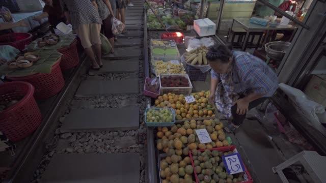 busy maeklong railway market, bangkok, thailand, southeast asia, asia - thailand stock videos & royalty-free footage