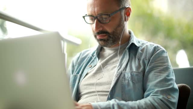 Busy man using laptop