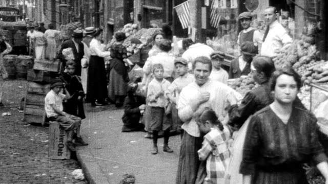 busy market on lower east side / old immigrant women haggling boys shoving each other in background lower east side market in manhattan in new york... - 1916 stock videos & royalty-free footage
