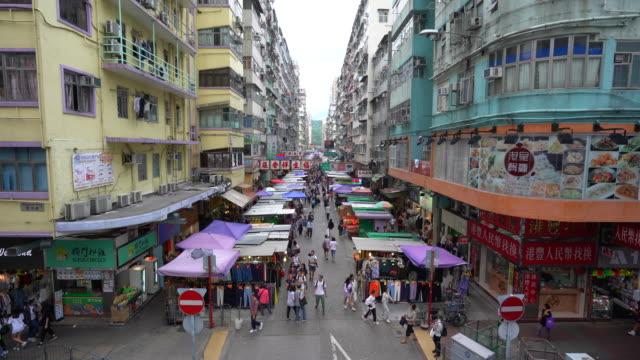 busy market street in mong kok, hong kong - mong kok stock videos & royalty-free footage