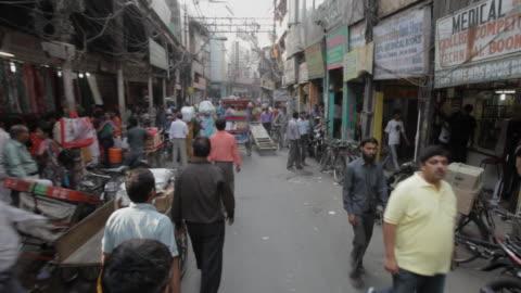 pov ws pan busy market street / new delhi, india - india stock videos & royalty-free footage