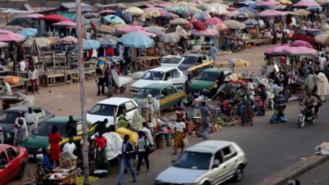 ha ms busy market street nigeria is home to nearly 200 million people which has earned it the name giant of africa it is an oil rich country which... - jos nigeria stock videos & royalty-free footage
