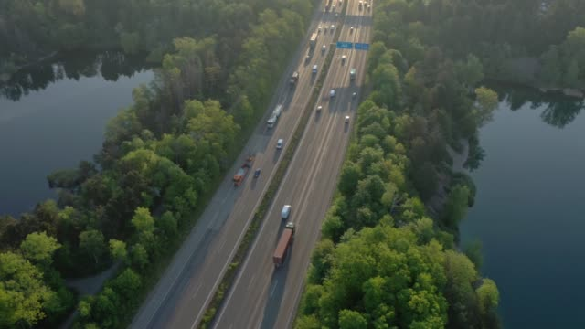 busy motorway at sunrise - articulated lorry stock videos & royalty-free footage