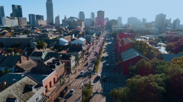 busy north rampart street in new orleans, louisiana, at evening, with the remote view along the street to the downtown financial district. aerial drone video with the cinematic slow forward camera motion. - new orleans stock videos & royalty-free footage
