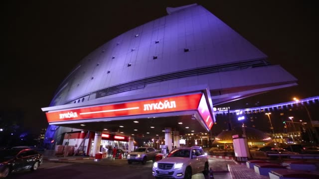 busy oao lukoil gas station stands illuminated in moscow, russia on monday, december 1 close ups of the lukoil logo, gvs of the gas station with cars... - moscow russia video stock e b–roll