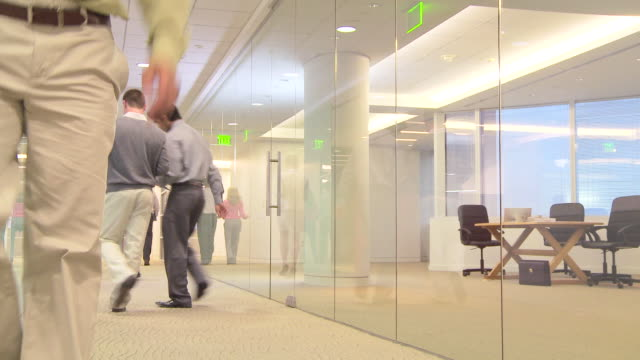 busy office workers meeting in hallway - low angle view stock videos & royalty-free footage