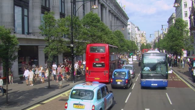 busy oxford street in london (tracking shot). - road sign stock videos & royalty-free footage