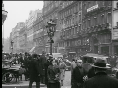 B/W 1927 busy Paris street with people walking on sidewalk + traffic on street / Paris, France