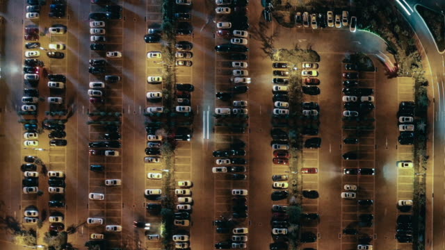 t/l busy parking lots at night - car park stock videos & royalty-free footage